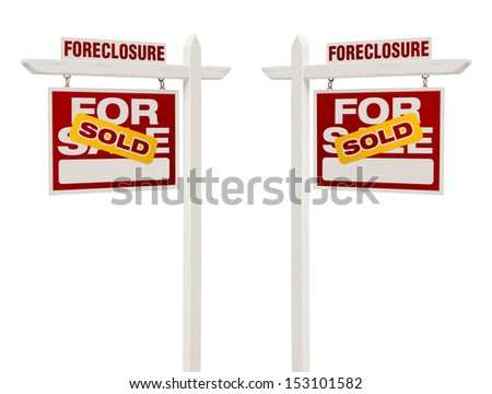Pair of Left and Right Facing Sold Foreclosure For Sale Real Estate Signs With Clipping Path Isolated on White. - stock photo