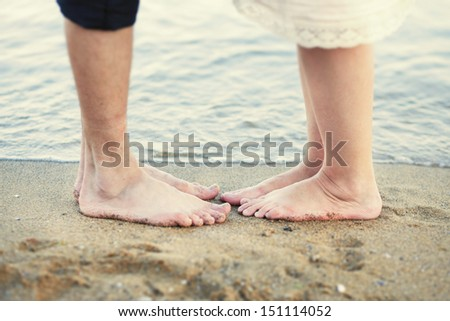 pair of legs on the beach