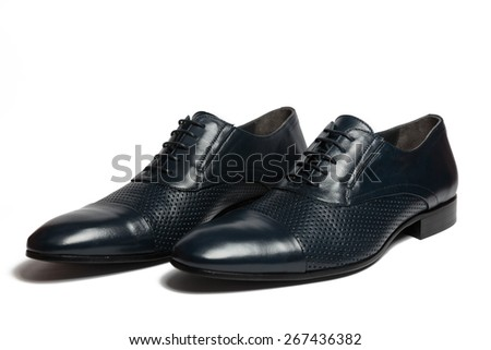 Pair of male classic leather shoes isolated on the white background