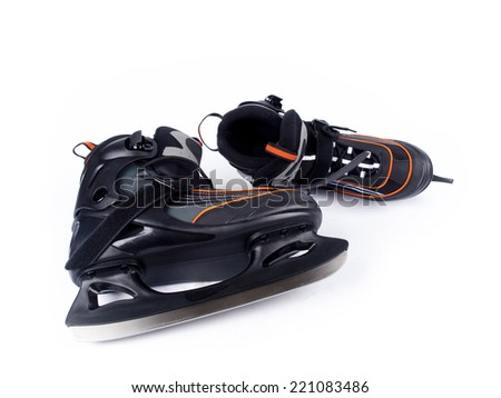Pair of man ice hockey skates over a white background - stock photo