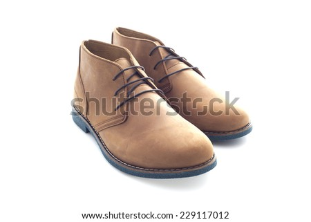 Pair of Mens Suede Shoes on a White Background - stock photo