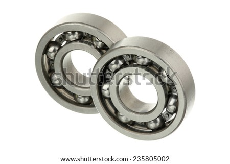 Pair of metallic bearings isolated over white background  - stock photo