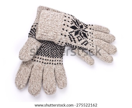 Pair of mitten with ornament on white background - stock photo