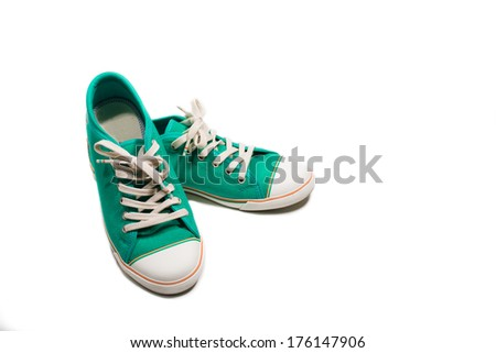 Pair of new green sneakers isolated on white