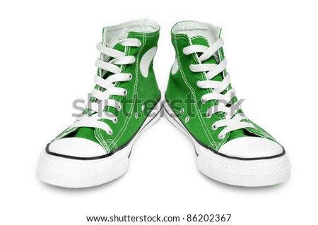 Pair of  new green sneakers isolated on white background - stock photo