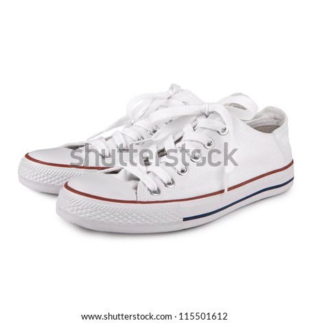 Pair of new white sneakers on white background - stock photo