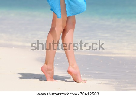Pair of nice legs walking on a beautiful beach in Maldives - stock photo