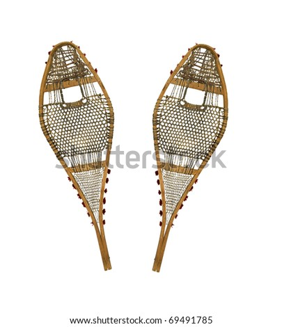 pair of old repaired snowshoes on a white background
