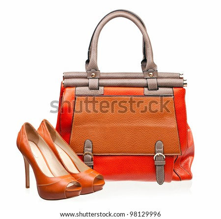 Pair of open-toe female shoes and handbag over white - stock photo