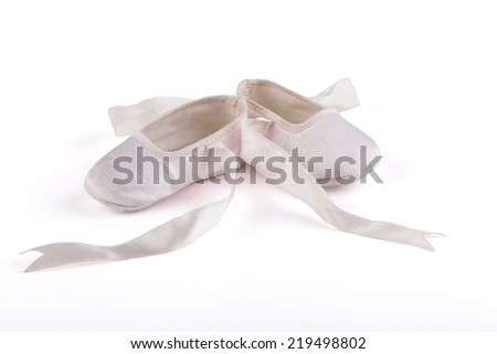 Pair of pink baby ballerina shoes isolated on white background - stock photo