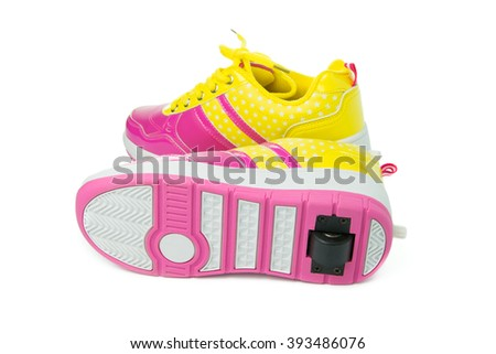 Pair of pink heelys on white background