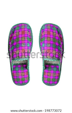 Pair of  pink home wool slippers on white background