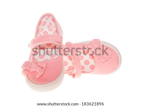 Pair of pink shoes isolated on white - stock photo