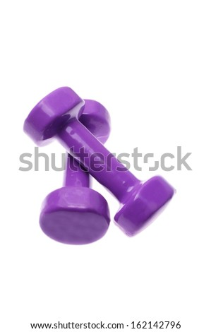 Pair of purple dumbbells Isolated on white background  - stock photo