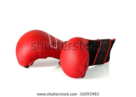 Pair of red boxing gloves against a white background