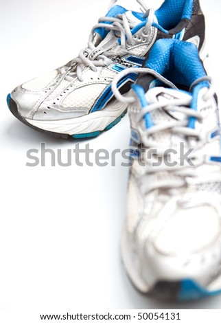 Pair of running shoes on a white background - stock photo