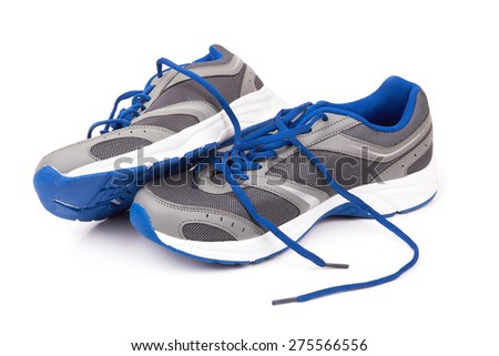 pair of running shoes over a white background - stock photo
