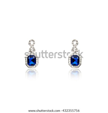 Pair of sapphire earrings isolated on white