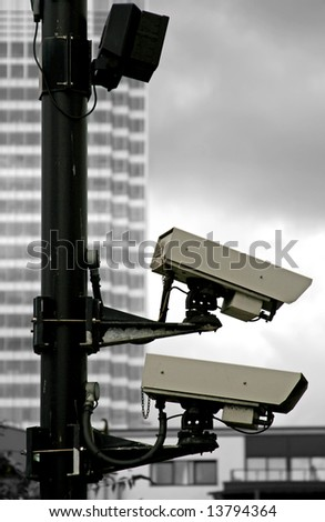 pair of security camera on black and white background - stock photo