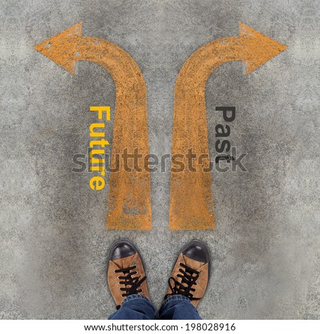 Pair of shoes and two arrows with Future, Past - stock photo