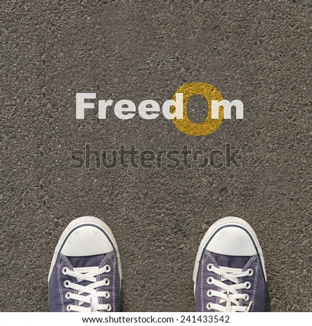 Pair of shoes standing on a road with text  - stock photo