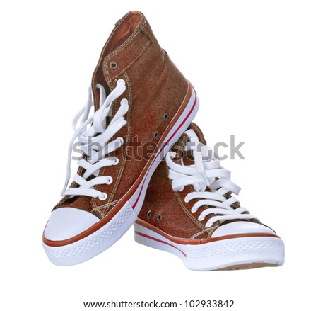 pair of simple gumshoes ( sneakers ) of denim canvas  on a white background - stock photo