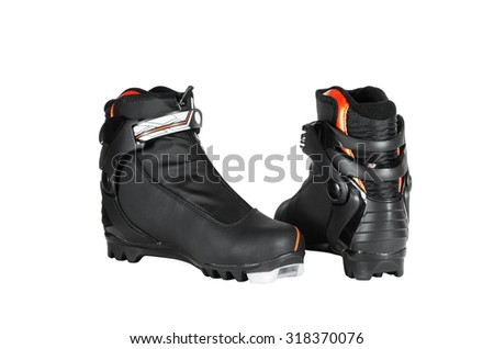 Pair of ski boots black colours. Isolated on white background