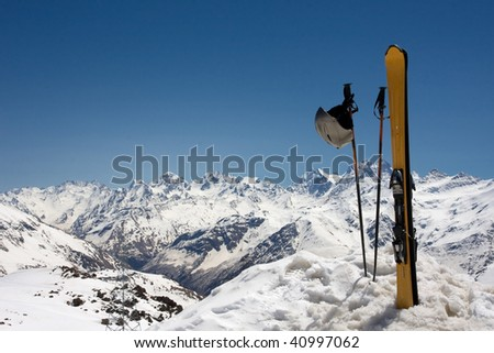 Pair of skis in snow - stock photo