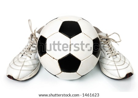 Pair of sneakers and soccer ball conceptual still-life isolated on white background
