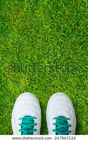 Pair Of Soccer Shoes On brown wood board - stock photo