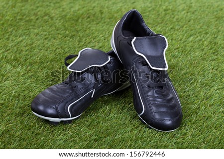 Pair Of Soccer Shoes On Grass Field - stock photo