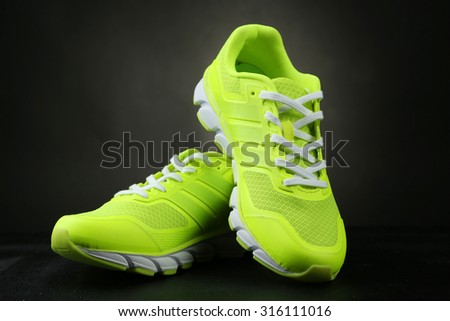 Pair of sport shoes on black background - stock photo
