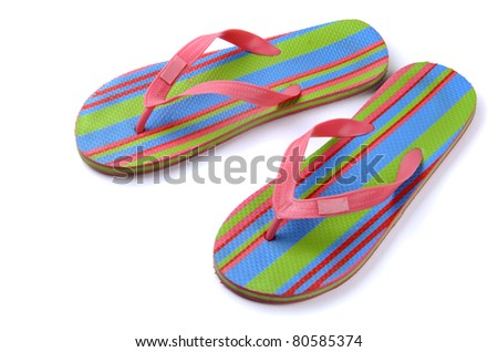 Pair of striped flip-flop sandals isolated on white - stock photo
