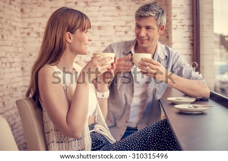 pair of students talking of plans - stock photo