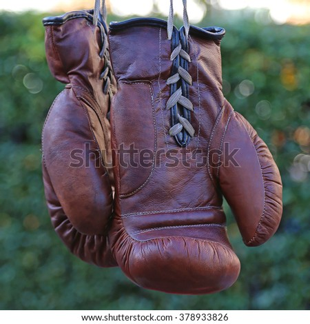 Pair of Vintage Brown Leather Boxing Gloves - stock photo