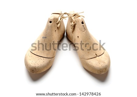 Pair of vintage wooden shoe lasts - stock photo