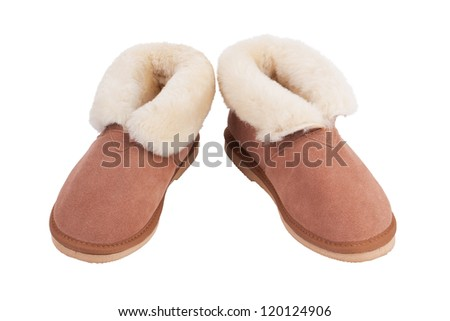 Pair of warm slippers of wool on a white background - stock photo