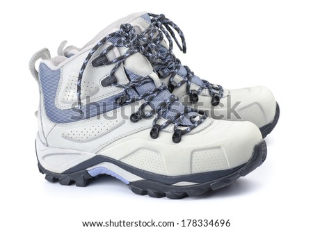 Pair of waterproof winter boots isolated on white - stock photo