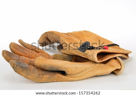 Pair of well-used, heavy duty leather work gloves on white background. - stock photo