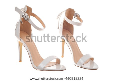 Pair of white high heel woman shoe isolated on white background
