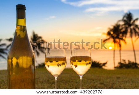 Pair of wine classes in a beach holiday setting.  - stock photo