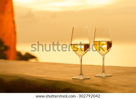 Pair of wine glasses in a beautiful setting.  - stock photo