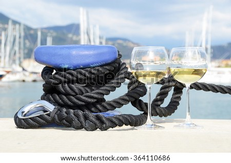 Pair of wineglasses against yachts in La Spezia, Italy - stock photo