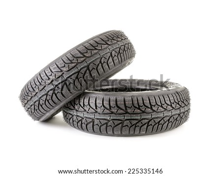 Pair of winter car tyres shot on white - stock photo
