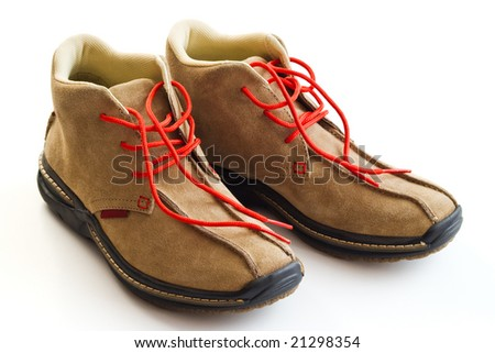 pair of winter shoes with red shoe lace isolated on white