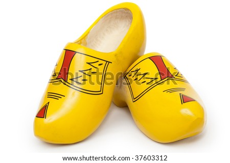 Pair of wooden shoes - klompen. Traditional dutch footwear for farmers. Isolated on white background - stock photo