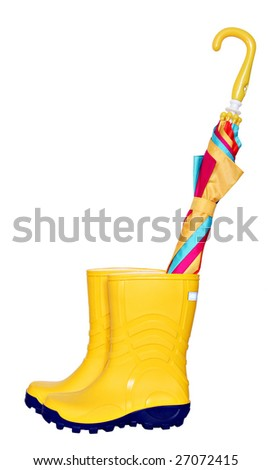 Pair of yellow rubber boots with colorful umbrella isolated on white