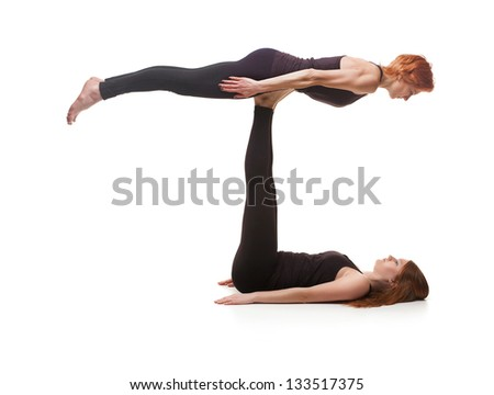 paired yoga two women practicing yoga stock photo royalty