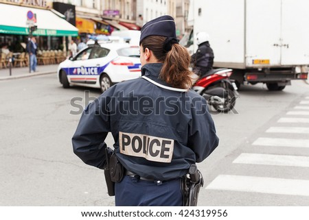Pairs, France - May 15, 2013.:Uniformed Paris Police officers patrolling traffic near the River Seine in Paris, France - stock photo