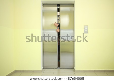 Pairs of male arms sticking out of the elevator doors & Pairs Male Arms Sticking Out Elevator Stock Photo 487654558 ...